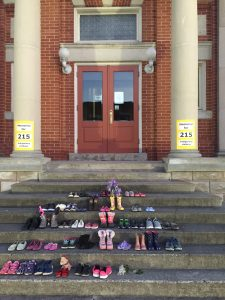 Shoes on library steps in memorial for Indigenous children.