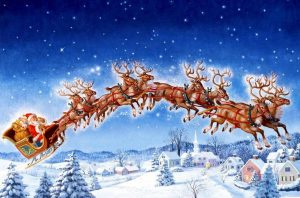 santa in his sleigh with reindeer.